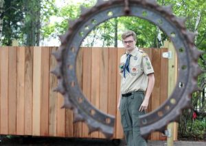 Reagan Patrick Butler of Troop 28 stands by the gate he built for his Eagle Scout project that hides the South Shore Art Center's dumpster from view. About 10-12 Scouts helped him out over 52 hours. Wicked Local Staff photo/ Robin Chan